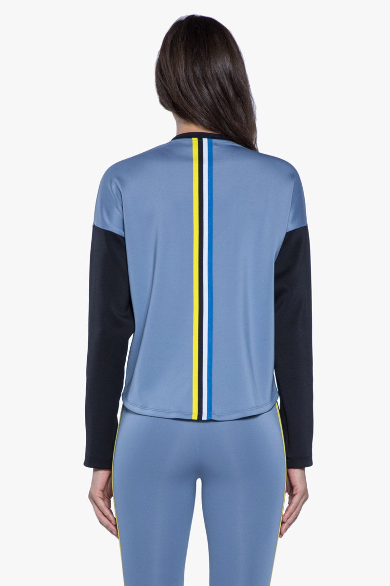 KORAL Ace Jacket - Nova Blue Jacket | Nova Blue| KORAL Ace Jacket.Nova Blue.Features:  Color blocked, front cropped jacket with black trim Meant for Athleisure performance  Fabric: Scuba 86% Polyester, 14% Spandex Machine wash cold, inside out with like colors; No bleach; Tumble dry low MADE IN USA Back View