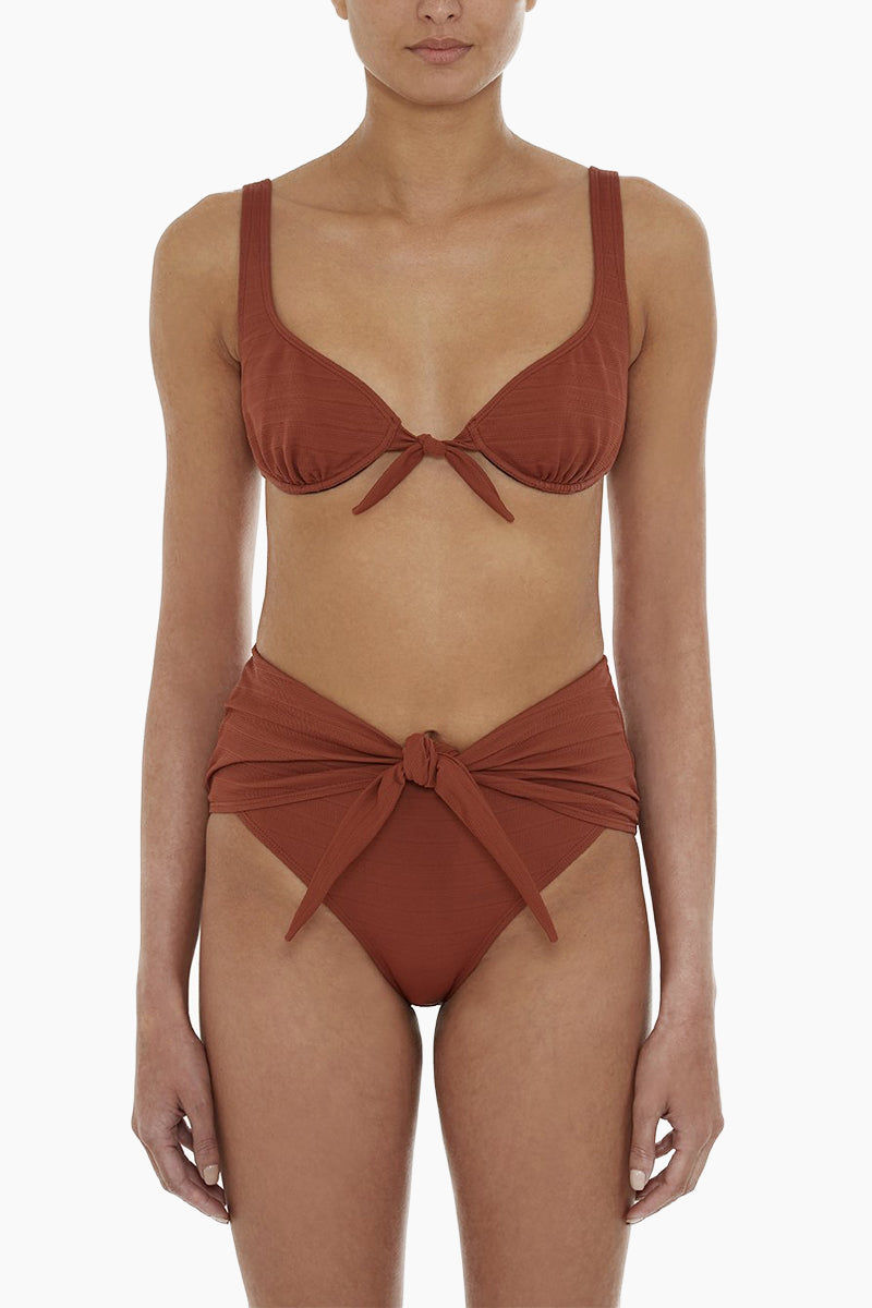 PRISM Marseille High Waist Front Tie Bikini Bottom - Autumn Stripe Texture Bikini Bottom   Autumn Stripe Print  Prism Marseille High Waist Front Tie Bikini Bottom - Autumn Stripe Print Features:   High waist  Front knot detail High cut leg Moderate-full coverage  Handmade in Italy     ****recommended to size down Front View