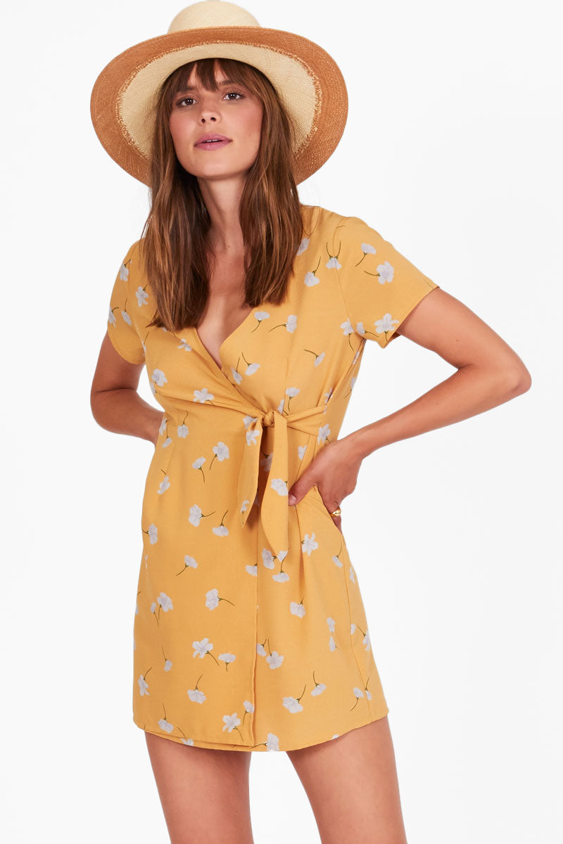 AMUSE SOCIETY Elena Short Sleeve Wrap Mini Dress - Sunray Yellow Floral Print Dress | Sunray Yellow Floral Print| Amuse Society Elena Short Sleeve Wrap Mini Dress - Sunray Yellow Floral Print  Walk through the euro streets with the Elena Dress featuring a wrap tie front and delicate flower print. Front View