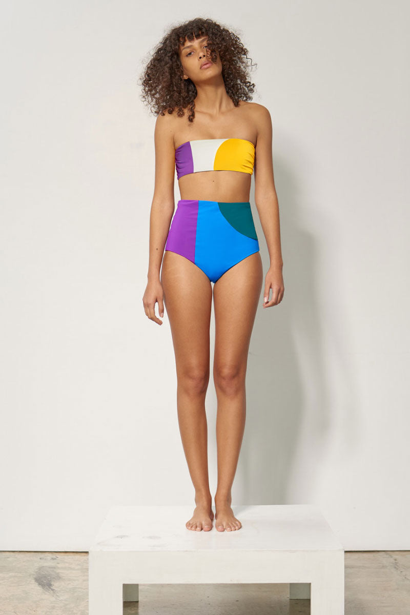 MARA HOFFMAN Lydia Color Block High Waist Bikini Bottom - Abacus Geometric Print Bikini Bottom | Abacus Geometric Print| Mara Hoffman Lydia Color Block High Waist Bikini Bottom - Abacus Geometric Print High-waisted bikini bottom in a vibrant color blocked print. Geometric abacus-inspired print is perfectly contrasted in royal purple, cerulean blue, and deep turquoise. Moderate to full coverage design Front View