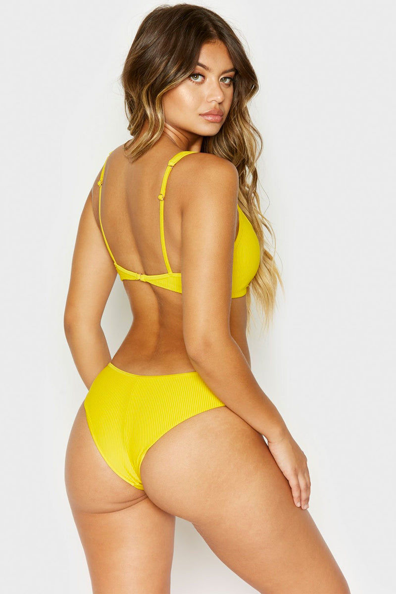 FRANKIES BIKINIS Alana Ribbed Button Up Front Cheeky Bikini Bottom - Amber Yellow Bikini Bottom | Amber Yellow| Frankies Bikinis Alana Ribbed Button Up Front Cheeky Bikini Bottom - Amber Yellow Low-rise henley inspired button front ribbed cheeky bikini bottom in amber yellow. Back View