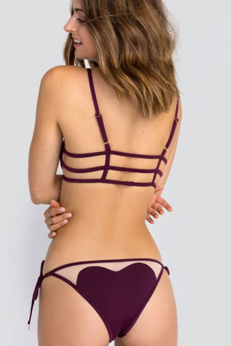WILDFOX Amora Bra Bikini Top | Fig| Wildfox Amora Bra back view Fig color heart shaped swim bralette with cage strapping detail.