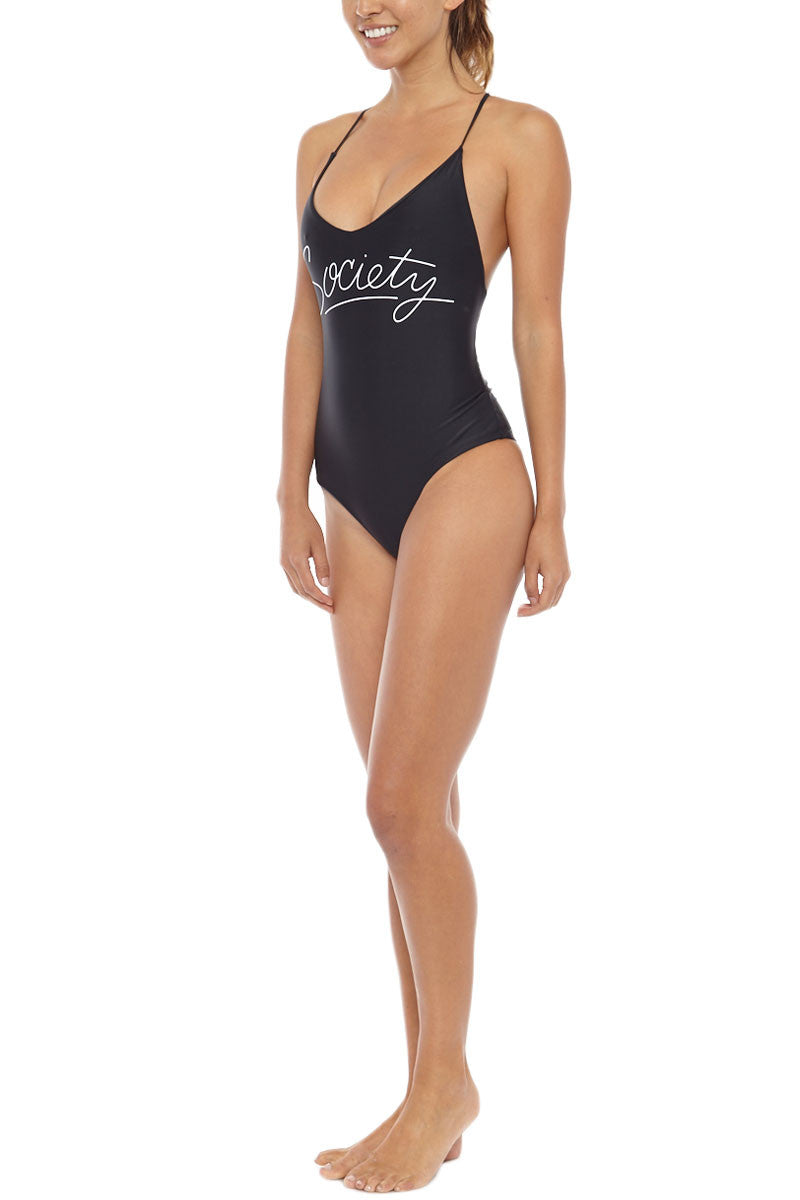 """AMUSE SOCIETY Society Strappy T Back One Piece Swimsuit - Black One Piece   Black  Amuse Society Society Strappy T Back One Piece Swimsuit - Black Strappy t back """"society"""" graphic one-piece swimsuit in sleek black. Sleek black swim fabric with logo graphic in white across the center front T back with thin strappy back details creates a flirty cutout design Mid-cut leg Front View"""