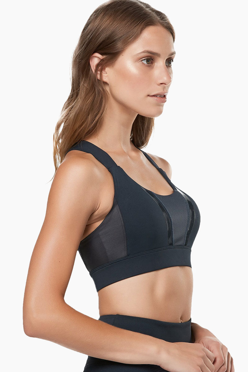 LILYBOD Aria Sports Bra - Blue Graphite Activewear | Blue Grapl| Lilybod Aria Sports Bra - Blue Graphite. FEATURES:  Optimum structure and firm support Mesh front panel with hi-gloss edge Extra wide straps with X-back finish Our signature 73%Poly/27%Spandex soft-touch fabric. View: Side View.