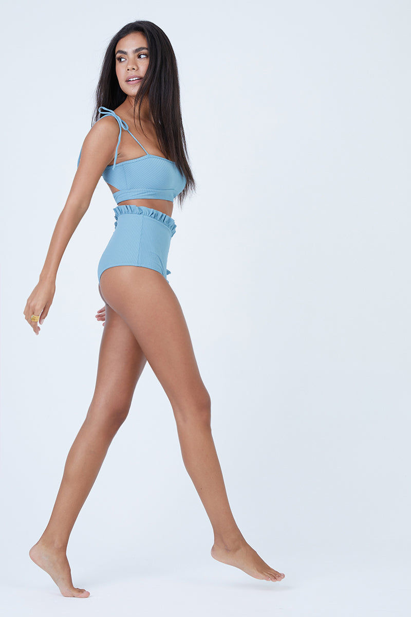 MADE BY DAWN Arrow Crop Shoulder Ties Bikini Top - Sky Rib Bikini Top |  Sky Rib| Made by Dawn Arrow Crop Shoulder Ties Bikini Top - Sky Rib. Features: Full coverage bandeau with Tie straps Back cutout Sky ribbed jacquard fabric. 88% Micro-Nylon, 12% Spandex Made in the USA Front View