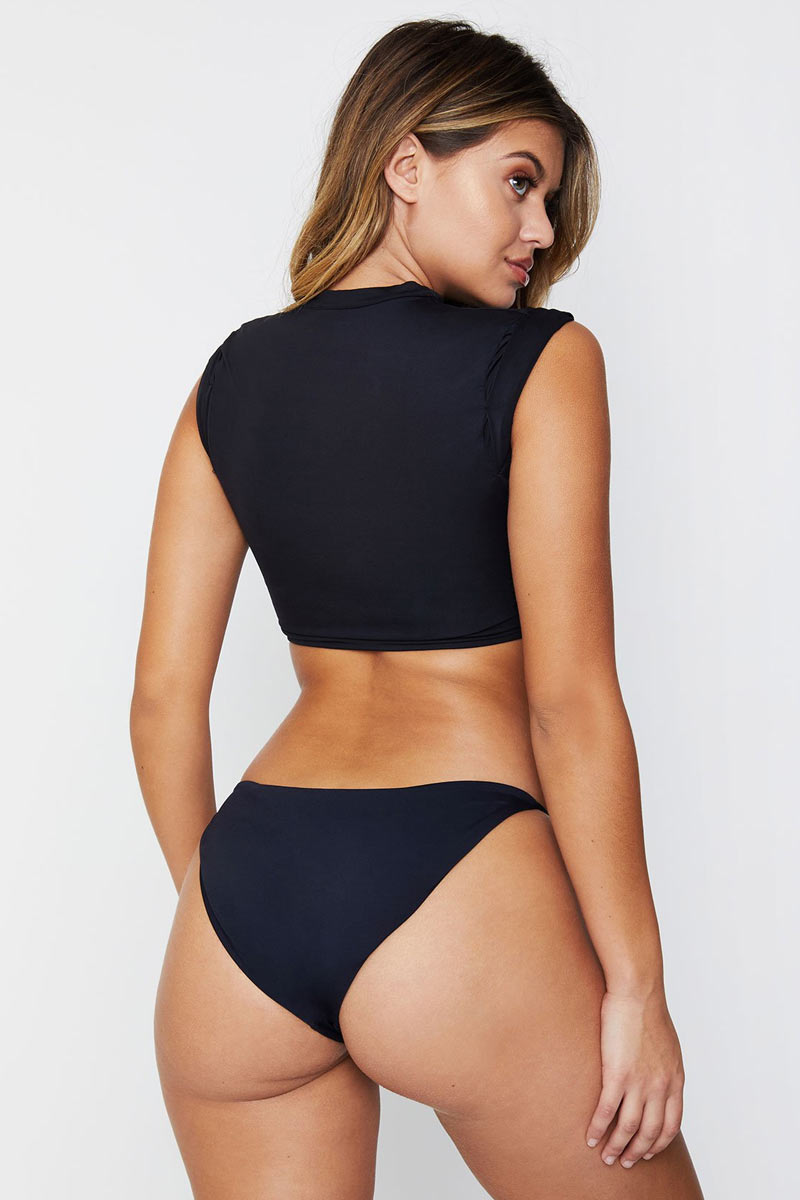 FRANKIES BIKINIS Ashley Low Rise Cheeky Bikini Bottom - Black Bikini Bottom | Black|Ashley Bottom - This chic and minimal string side bottom is anything but basic, with classic coverage and our signature luxe fabric this style is a swim staple. Pair these simply sexy bottoms with the Ashley top for a trend-setting look.