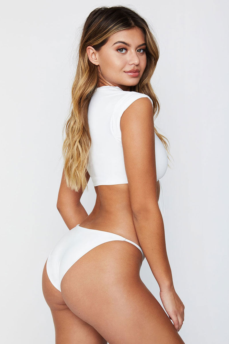 FRANKIES BIKINIS Ashley Top - White Bikini Top | White|Ashley Top - We took the simplicity of a muscle tee and made it femme with a lace up corset inset and roll sleeves. Pair this top with the Ashley bottoms for a minimalistic and trendy look.