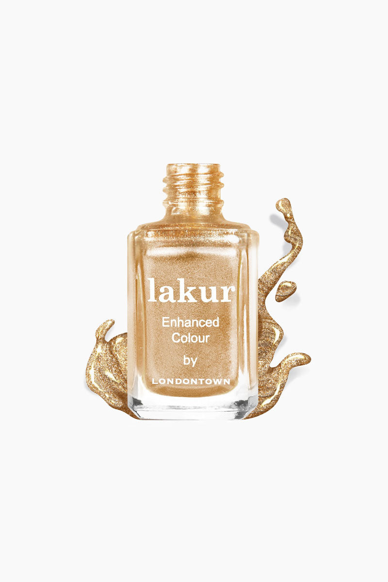 LONDONTOWN Best Of British Nail Polish - Gold Shimmer Nails | Gold| Londontown Best Of British Nail Polish - Gold. Features This liquefied,  gold shimmer will look like the king's crown melted on your tips.      Give your nails the good stuff. Florium Complex infused Lakur takes color to the next level by fusing bold hues with enriching botanicals to deliver long-lasting., high-shine wear that hydrates and strengthens with every application. Don't choose between nail care and color, pick both.     Made in USA 9-Free, Cruelty-Free, Vegan