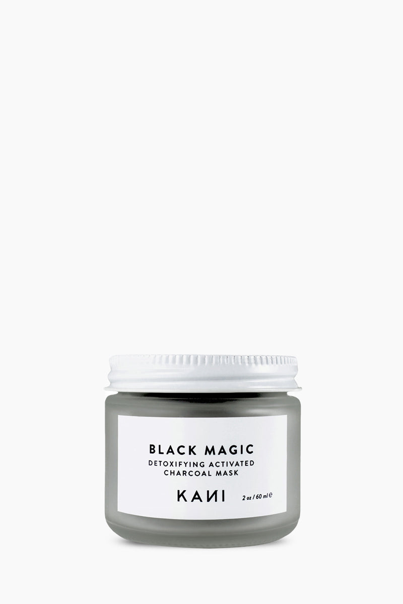 KANI BOTANICAL BEAUTY Black Magic Charcoal Detox Mask Beauty | Kani Botanical Beauty Black Magic Charcoal Detox Mask Detox oily & acne prone skin and helps promote new cell turnover with fruit enzymes. This facial mask is a blend of kaolin clay, activated bamboo charcoal, white willow bark, chamomile, pineapple, and papaya enzymes. Front View