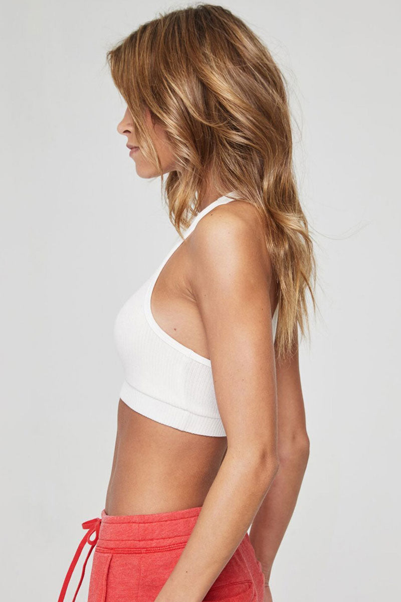 SPIRITUAL GANGSTER Ballet Ribbed Racerback Sports Bra - Stone White Top | Stone White| Spiritual Gangster Ballet Ribbed Racerback Sports Bra - Stone White Scoop Neckline Racerback Hidden Elastic Band  Double Layered For Extra Support & Coverage  Made from soft ribbed Viscose/Spandex Side View