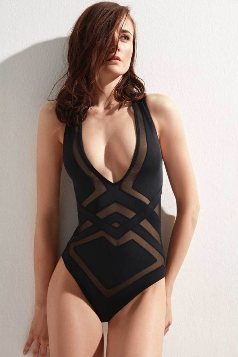 OYE SWIMWEAR Bane Mesh Cut Out One Piece Swimsuit - Black One Piece | Black| Oye Swimwear Bane Mesh Cut Out One Piece Swimsuit - Black. Features:Black, figure-enhancing one piece swimsuit. Geometric mesh detailing in front and back. Deep v-neckline is flattering for all breast sizes. Geometric mesh detailing in front and back. Shoulder straps cross in back for support and comfort . Sleeveless with thick tank top straps providing moderate shoulder coverage.  Easy pull-on. Full bottom coverage. Can be worn as body suit.