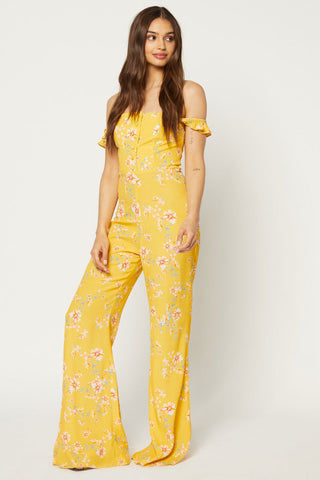 FLYNN SKYE Bardot Jumpsuit - Touch Of Honey Jumpsuit | Touch Of Honey| Flynn Skye Bardot Jumpsuit - Touch Of Honey Button detailing Ruffle sleeves worn on or off shoulders 100% Rayon Dry clean Made in Los Angeles Front View