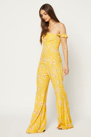 FLYNN SKYE Bardot Jumpsuit - Touch Of Honey Jumpsuit | Touch Of Honey| Flynn Skye Bardot Jumpsuit - Touch Of Honey Button detailing Ruffle sleeves worn on or off shoulders 100% Rayon Dry clean Made in Los Angeles Side View