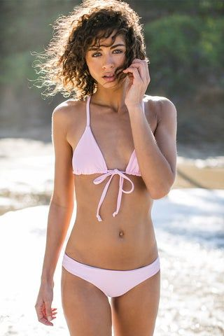 BETTINIS Triangle T Back Bikini Top - Baby Pink Bikini Top | Baby Pink| Bettinis Triangle T Back Bikini Top - Baby Pink Adjustable triangles Tie closure in front Crochet back accent 83% Nylon, 17% Spandex Front View