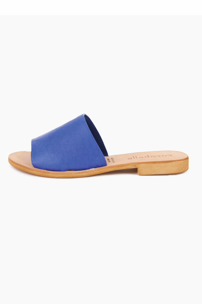COCOBELLE Bhea Slides - Blue Sandals | Blue| Cocobelle Bhea Slides - Blue. Features: This beautifully minimal slide sandal will go with just about anything. Handmade in Italy, these sandals are made of 100% leather and will only get better with age.   Handmade in Italy 100% Leather Side View