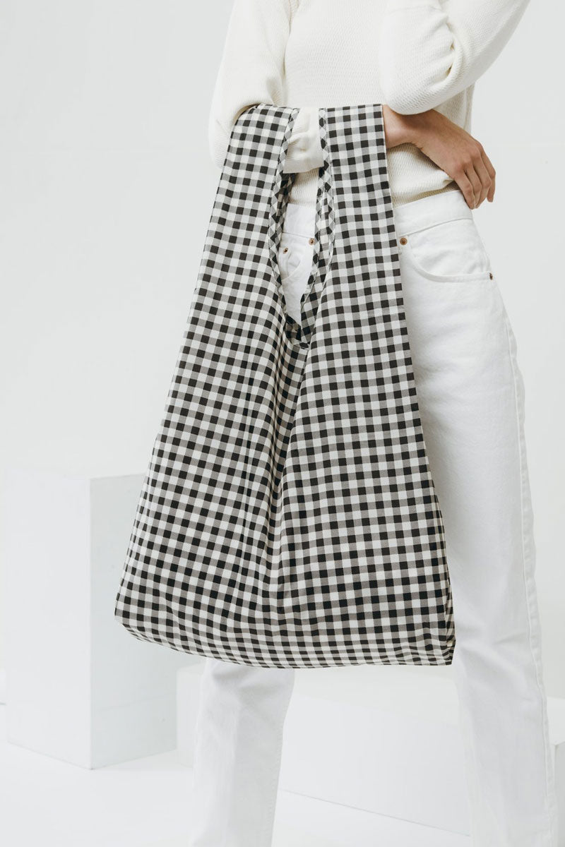 BAGGU Big Black Gingham Market Bag - Black Bag | Black|Big Black Gingham Bag - Features: Carry in your hand or over your shoulder Holds 2-3 plastic grocery bags worth of stuff Folds into a flat 5 in. x 5 in. pouch Holds 50 lbs 100% ripstop nylon Machine washable