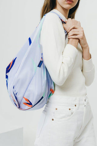 BAGGU Bird Of Paradise Market Bag - Blue Bag |  Blue|Bird Of Paradise Bag - Features: Carry in your hand or over your shoulder Holds 2-3 plastic grocery bags worth of stuff Folds into a flat 5 in. x 5 in. pouch Holds 50 lbs 100% ripstop nylon Machine washable