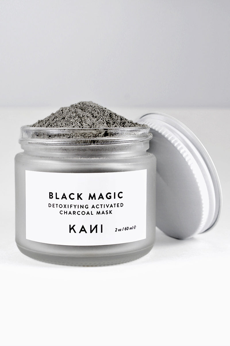 KANI BOTANICAL BEAUTY Black Magic Charcoal Detox Mask Beauty | | Kani Botanical Beauty Black Magic Charcoal Detox Mask Detox oily & acne prone skin and helps promote new cell turnover with fruit enzymes. This facial mask is a blend of kaolin clay, activated bamboo charcoal, white willow bark, chamomile, pineapple, and papaya enzymes. Front View
