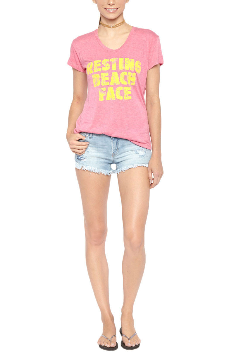 "BLAINE BOWEN Resting Beach Face Short Sleeve T-Shirt - Pink Top | Pink| Blaine Bowen Resting Beach Face Short Sleeve T-Shirt - Pink Pink scoop neck short sleeve T-shirt with yellow ""resting Beach Face"" graphic.  Ultra soft light-weight fabric in soft pink with vibrant faded yellow graphic print has a cool lived-in look. ""RESTING BEACH FACE"" Front View"