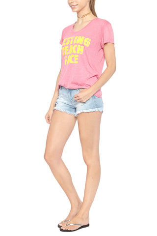 "BLAINE BOWEN Resting Beach Face Short Sleeve T-Shirt - Pink Top | Pink| Blaine Bowen Resting Beach Face Short Sleeve T-Shirt - Pink Pink scoop neck short sleeve T-shirt with yellow ""resting Beach Face"" graphic.  Ultra soft light-weight fabric in soft pink with vibrant faded yellow graphic print has a cool lived-in look. ""RESTING BEACH FACE"" Side View"