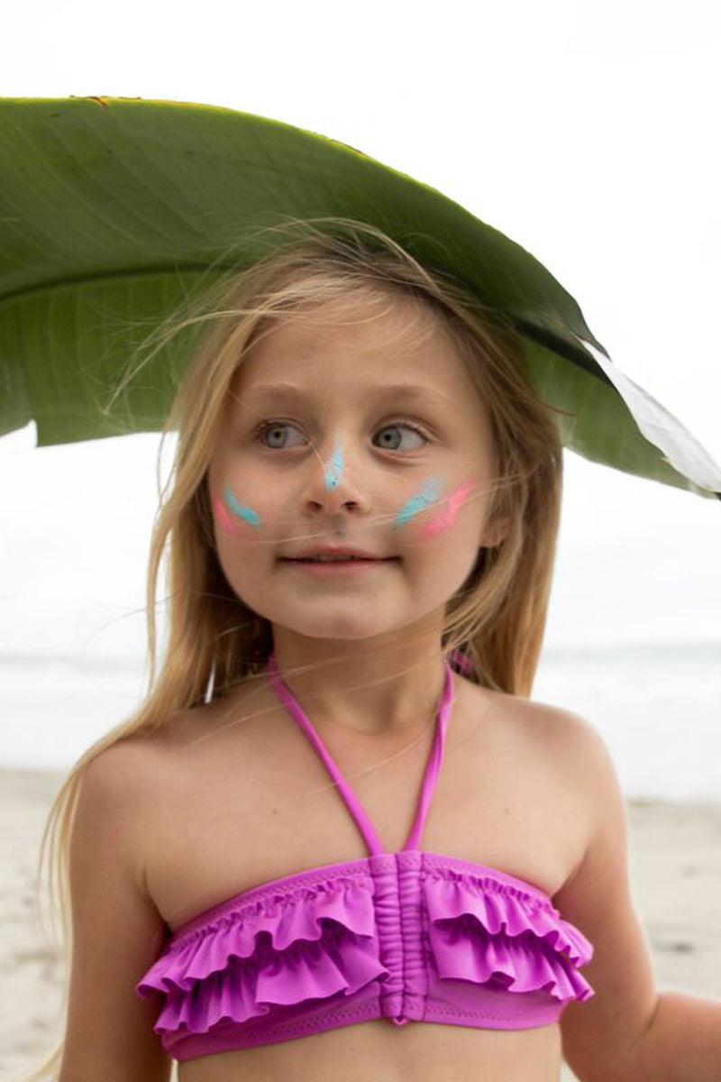 BOWIE JAMES Pink Warrior Bikini - Kids Kids Bikini | Pink| Bowie James Pink Warrior Kids Bikini Top And Bottom Cinching at Center Ruffle Overlay Adjustable Halter Straps Ties at Back Adjustable Side Ties on Bottom Full Rear Coverage UPF 30+