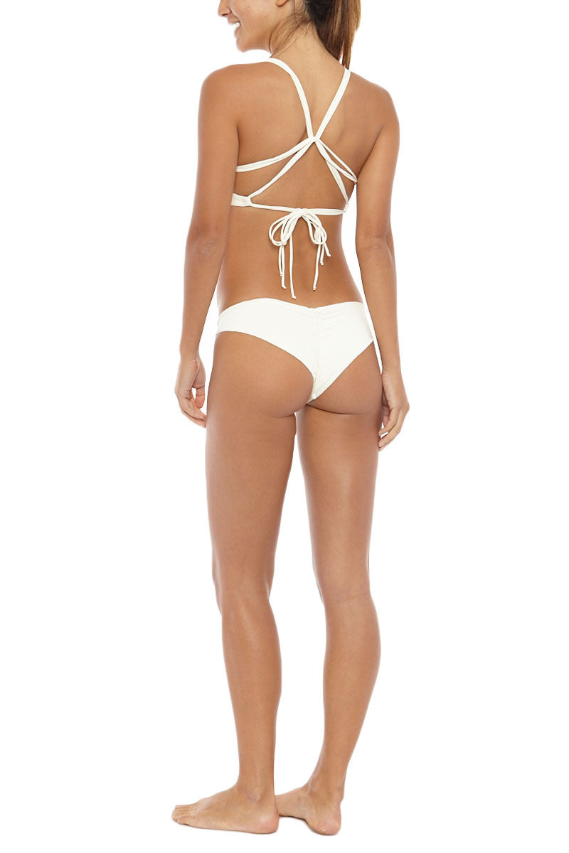 BOYS + ARROWS Kiki The Killer Cheeky Ruched Bikini Bottom - Blond White Bikini Bottom | Blond White| Boys + Arrows Kiki The Killer Cheeky Ruched Bikini Bottom - Blond White Back ruffle-edged and scrunch-butt Low rise  Cheeky coverage  Seamless 72% Polyamide, 28% Elastane  Back View