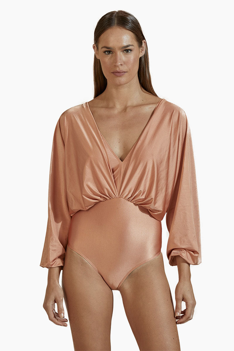 AGUA DE COCO Brazilian Long Sleeves One Piece Swimsuit - Rose Pink One Piece | Rose Pink| Agua De Coco Brazilian Long Sleeves One Piece Swimsuit - Rose Pink Plunging v neckline Gathered fabric  Long sleeves  Open back detail  Cheeky coverage  Front View