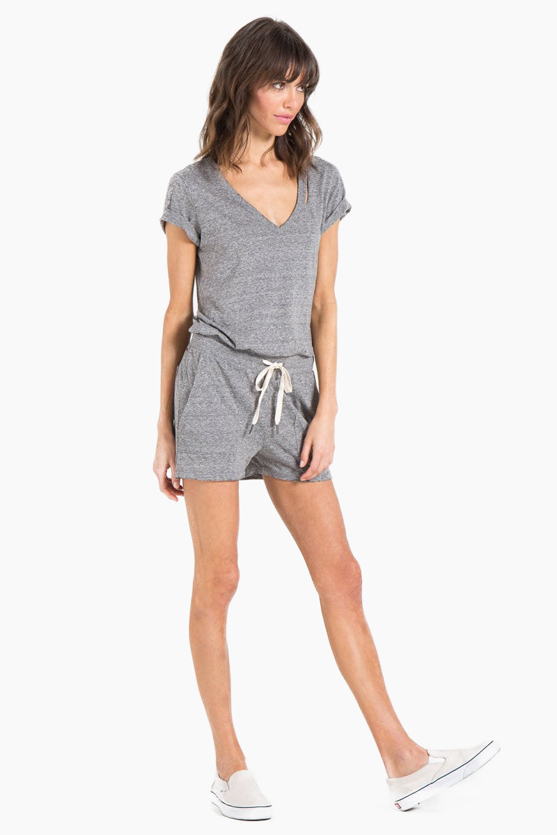 N:PHILANTHROPY Breeze Romper - Heather Grey Romper | Heather Grey| n:Philanthropy Breeze Romper - Heather Grey Short sleeve romper V neckline  Slit at neck Elastic waist with functional drawcord Front pockets Back keyhole cut out  Front View