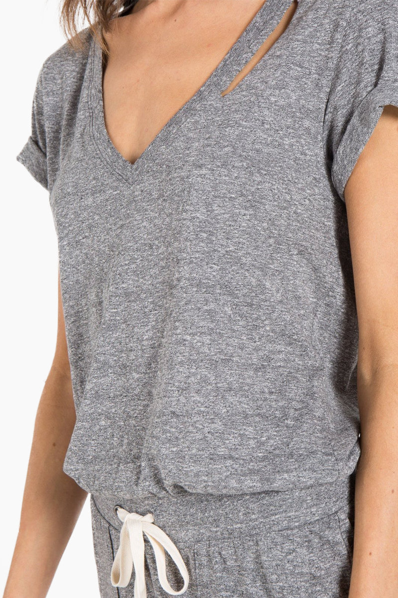 N:PHILANTHROPY Breeze Romper - Heather Grey Romper | Heather Grey| n:Philanthropy Breeze Romper - Heather Grey Short sleeve romper V neckline  Slit at neck Elastic waist with functional drawcord Front pockets Back keyhole cut out  Close View
