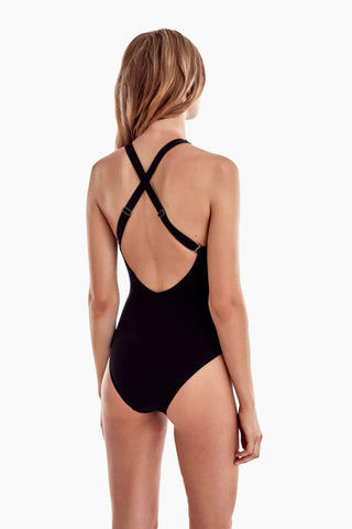 MOEVA Brooke High Neck Convertible One Piece Swimsuit - Black & White One Piece | Black & White| MOEVA Brooke High Neck Convertible One Piece Swimsuit - Black & White High neckline one piece swimsuit with deep cut sides is both athletic and chic, showing off your shoulders for a sweet and sultry look. Laser cut out details add a unique element to this one piece swimsuit showing the perfect peek of skin. Adjustable straps can be criss-crossed over back or worn straight over Back View