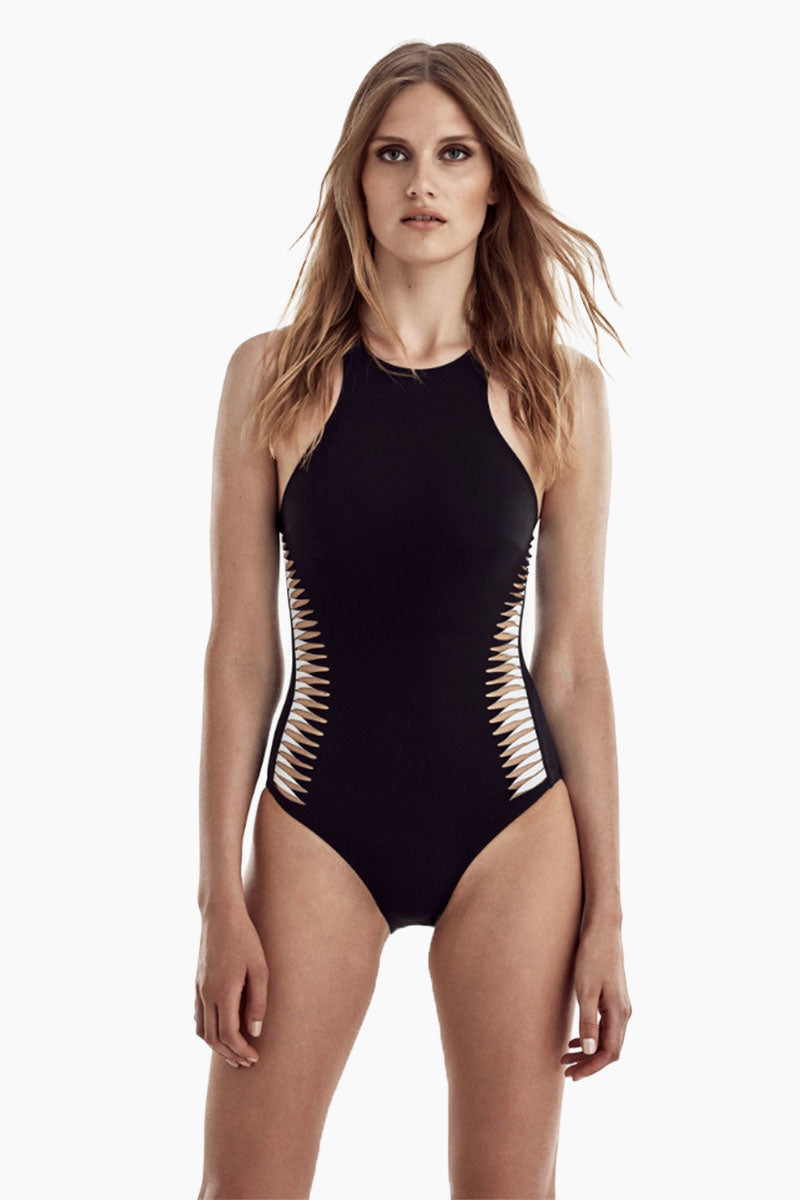 MOEVA Brooke High Neck Convertible One Piece Swimsuit - Black & White One Piece | Black & White| MOEVA Brooke High Neck Convertible One Piece Swimsuit - Black & White High neckline one piece swimsuit with deep cut sides is both athletic and chic, showing off your shoulders for a sweet and sultry look. Laser cut out details add a unique element to this one piece swimsuit showing the perfect peek of skin. Adjustable straps can be criss-crossed over back or worn straight over Front View