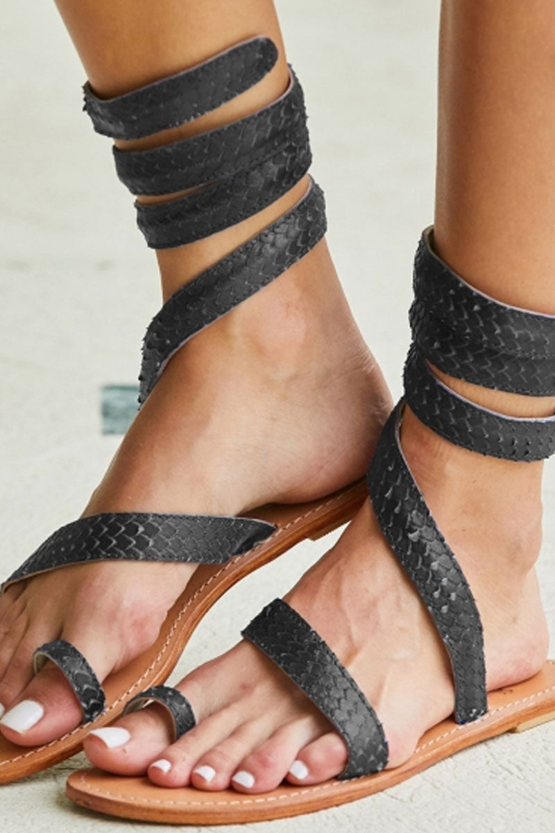 ASPIGA Cannes Sandals - Black Sandals | Black| Aspiga Cannes Sandals - Black Toe loop style Thin wire is encased with soft leather Wrapped around the leg - high or low depending on preference 100% leather  hand crafted in India Side View