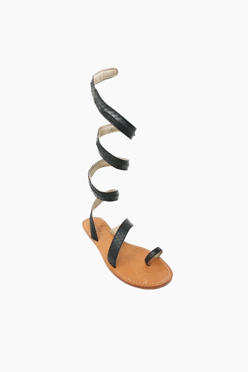ASPIGA Cannes Sandals - Black Sandals | Black| Aspiga Cannes Sandals - Black Toe loop style Thin wire is encased with soft leather Wrapped around the leg - high or low depending on preference 100% leather  hand crafted in India Angled View
