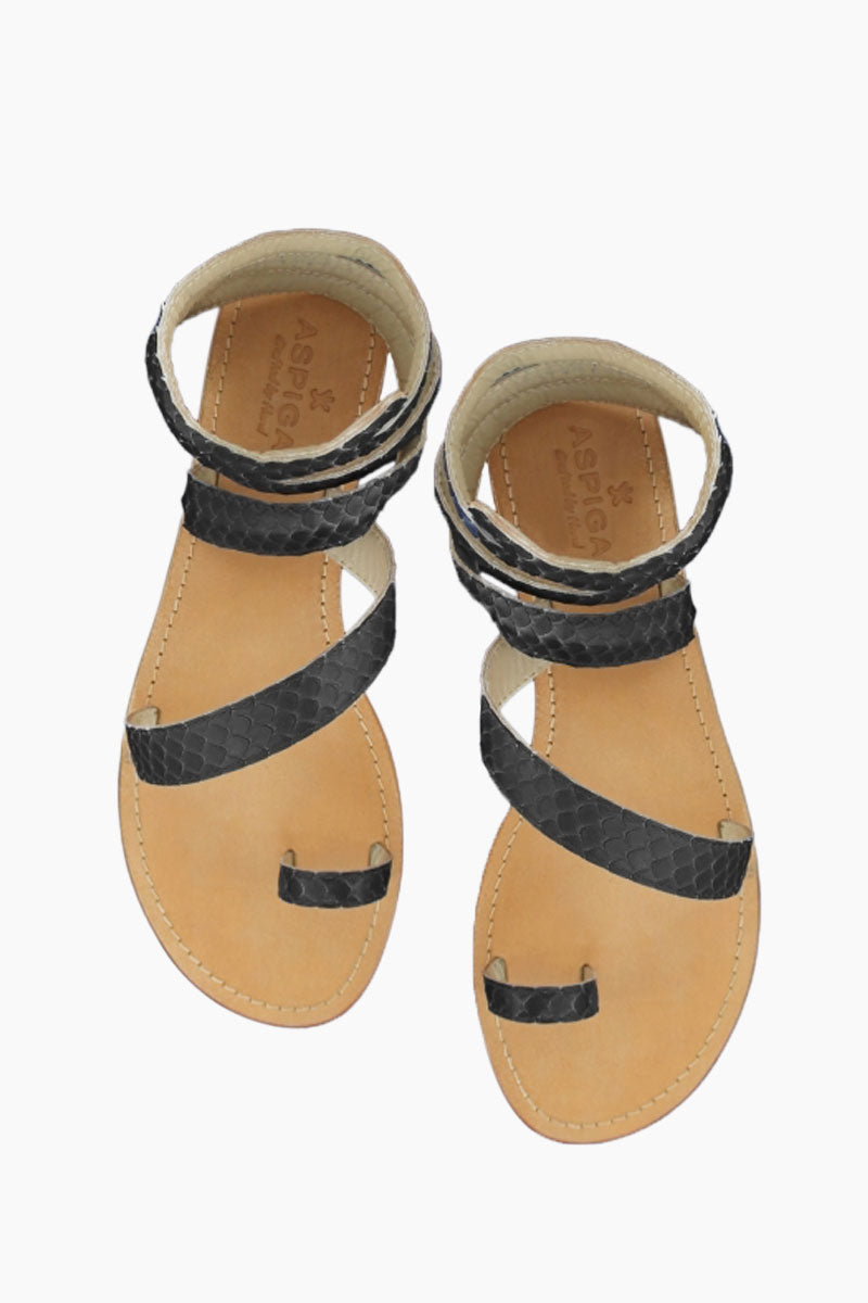 ASPIGA Cannes Sandals - Black Sandals | Black| Aspiga Cannes Sandals - Black Toe loop style Thin wire is encased with soft leather Wrapped around the leg - high or low depending on preference 100% leather  hand crafted in India Front View