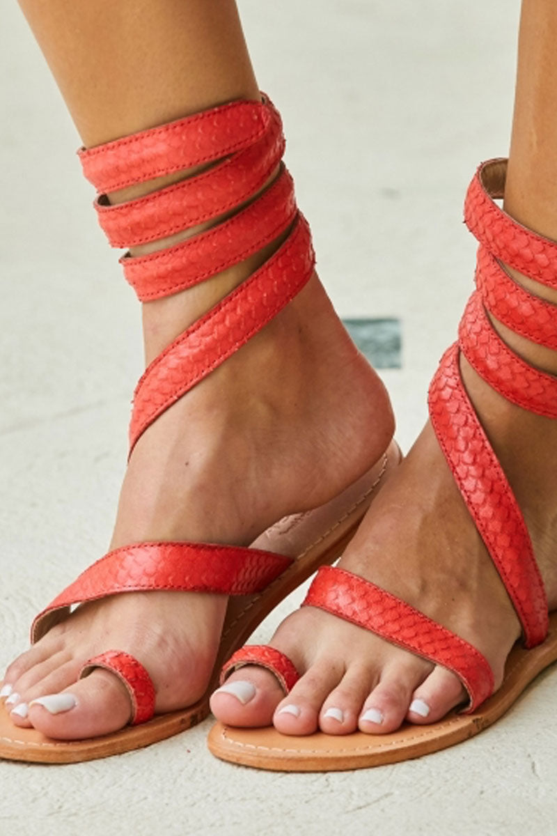 ASPIGA Cannes Sandals - Coral Sandals | Coral| Aspiga Cannes Sandals - Coral Toe loop style Thin wire is encased with soft leather Wrapped around the leg - high or low depending on preference 100% leather  hand crafted in India  Side View