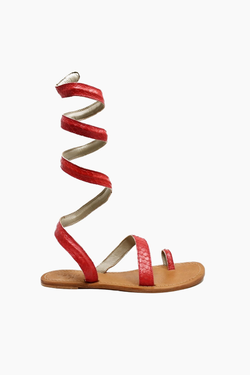 ASPIGA Cannes Sandals - Coral Sandals   Coral  Aspiga Cannes Sandals - Coral Toe loop style Thin wire is encased with soft leather Wrapped around the leg - high or low depending on preference 100% leather  hand crafted in India  Side View