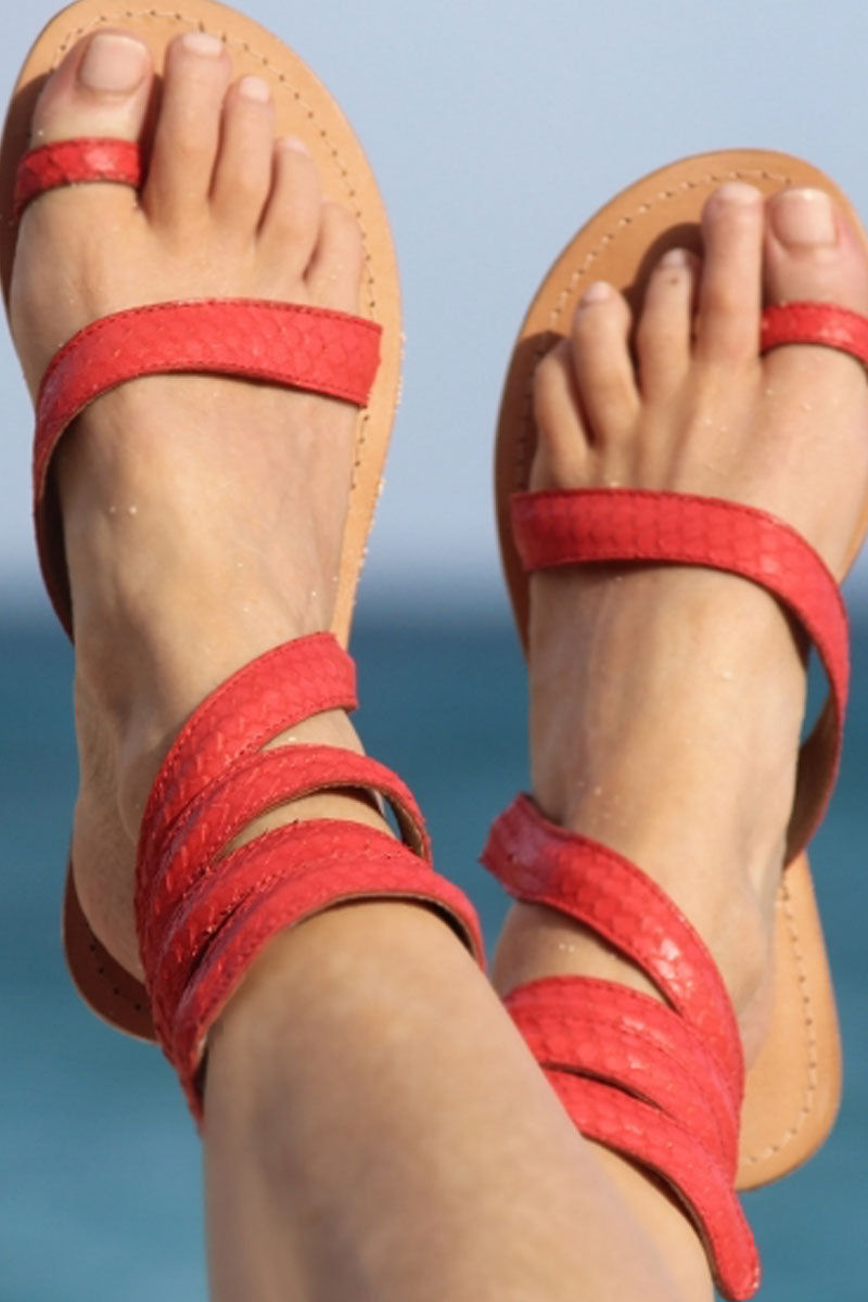 ASPIGA Cannes Sandals - Coral Sandals | Coral| Aspiga Cannes Sandals - Coral Toe loop style Thin wire is encased with soft leather Wrapped around the leg - high or low depending on preference 100% leather  hand crafted in India  Front View