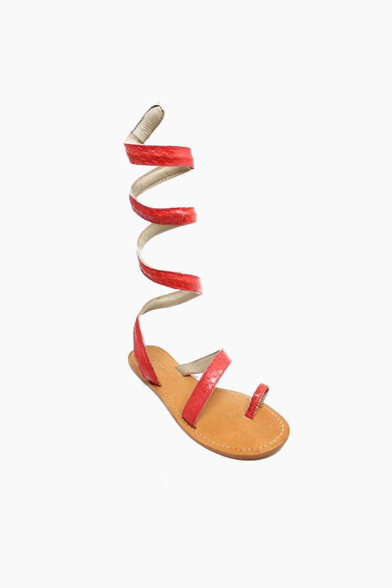 ASPIGA Cannes Sandals - Coral Sandals | Coral| Aspiga Cannes Sandals - Coral Toe loop style Thin wire is encased with soft leather Wrapped around the leg - high or low depending on preference 100% leather  hand crafted in India  Angled View