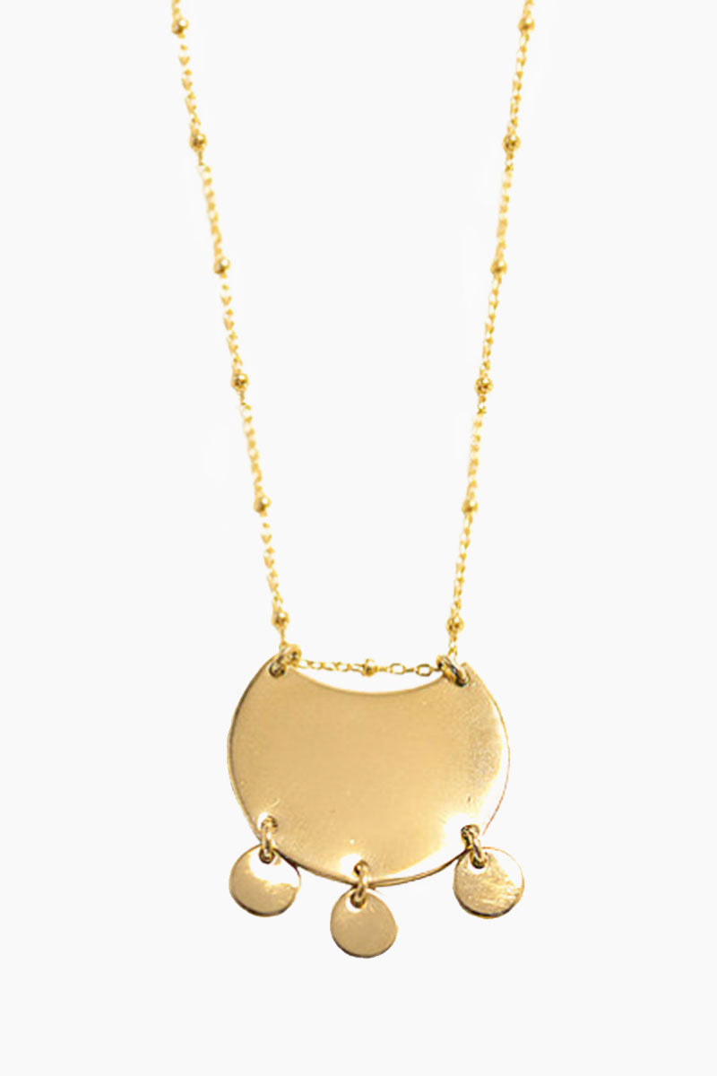 PARADIGM DESIGN Capri Necklace - Gold Jewelry | Gold| Paradigm Design Capri Necklace - Gold Semi circle coin with three small coins that dangle Hangs from delicate ball chain 18 inches with 2 inch extender Front View