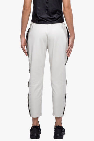 KORAL Chad Scuba Pants - Egret Pants | Egret| Koral Chad Scuba Pants - Egret. Features:  Relaxed fit Cropped above the ankle Drawstring elastic waistband Metallic bead trim detail outseams Fabric: Scuba - 86% Polyester, 14% Spandex Made in the U.S. Back View