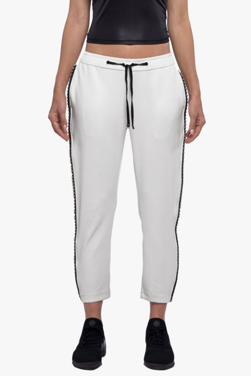 KORAL Chad Scuba Pants - Egret Pants | Egret| Koral Chad Scuba Pants - Egret. Features:  Relaxed fit Cropped above the ankle Drawstring elastic waistband Metallic bead trim detail outseams Fabric: Scuba - 86% Polyester, 14% Spandex Made in the U.S. Front View