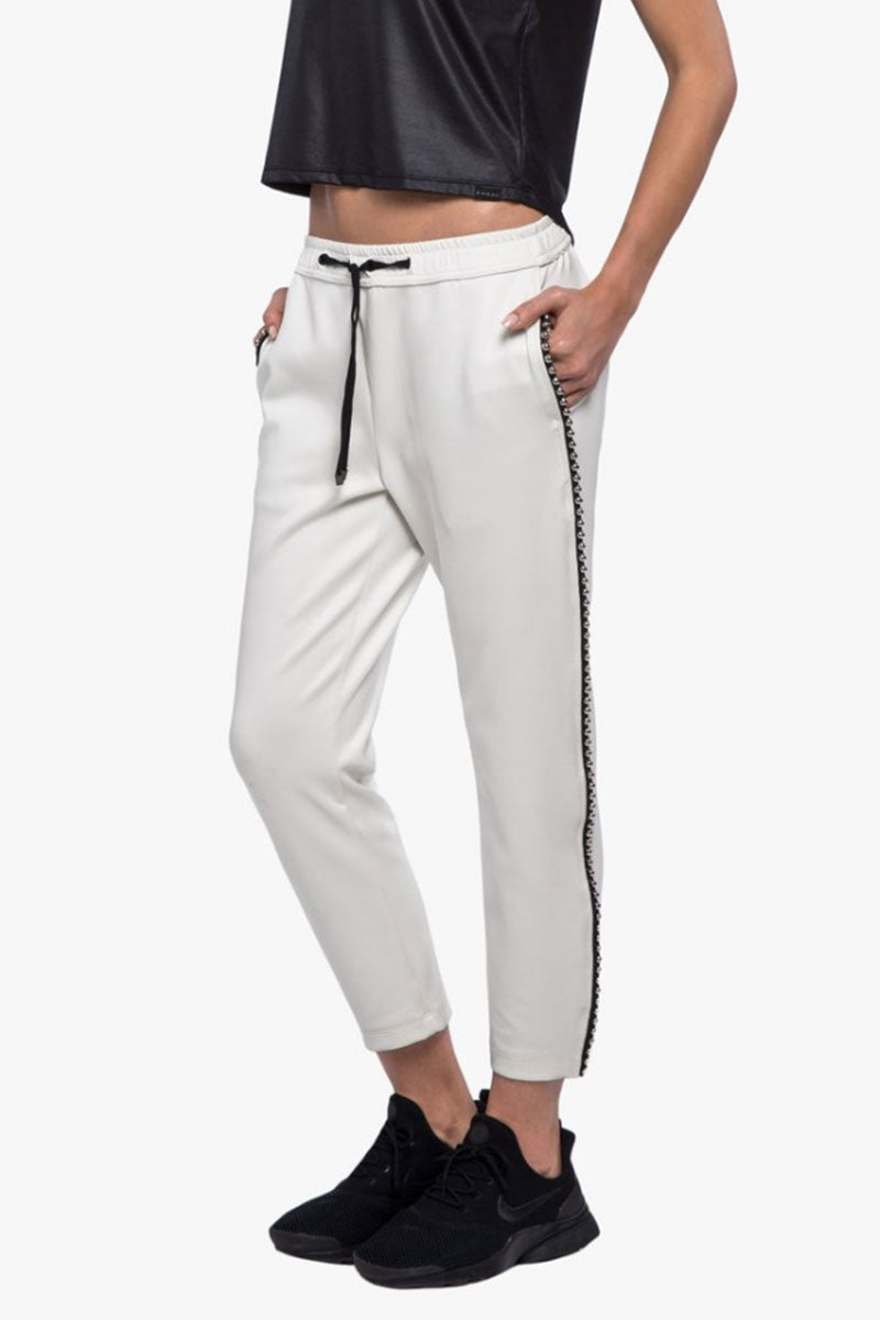 KORAL Chad Scuba Pants - Egret Pants | Egret| Koral Chad Scuba Pants - Egret. Features:  Relaxed fit Cropped above the ankle Drawstring elastic waistband Metallic bead trim detail outseams Fabric: Scuba - 86% Polyester, 14% Spandex Made in the U.S. Side View