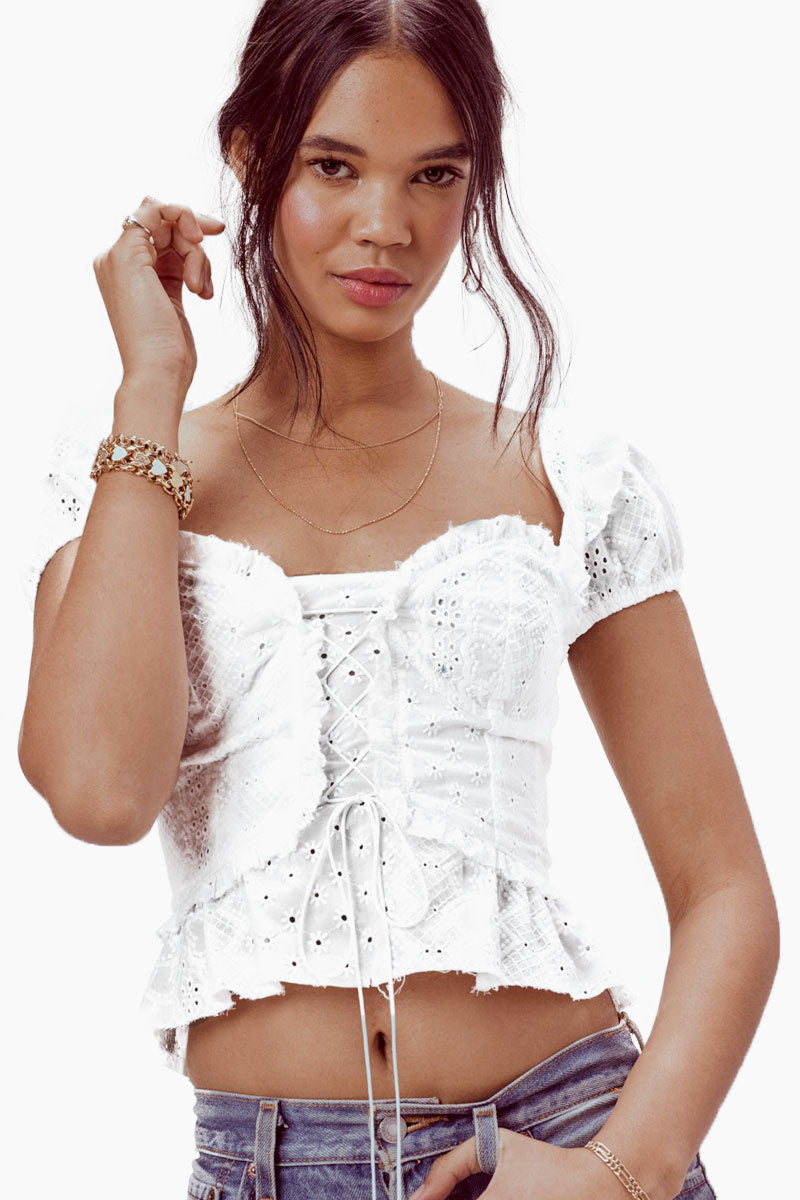 FOR LOVE AND LEMONS Charlotte Eyelet Lace Up Blouse - White Heart Top | White Heart| For Love And Lemons Charlotte Eyelet Lace Up Blouse - White Heart. Features:  Soft cotton heart eyelet Flattering neckline Adjustable Lace Up Details Exposed Center Back Zipper Lined in Front Bodice Dry Clean Only Front View