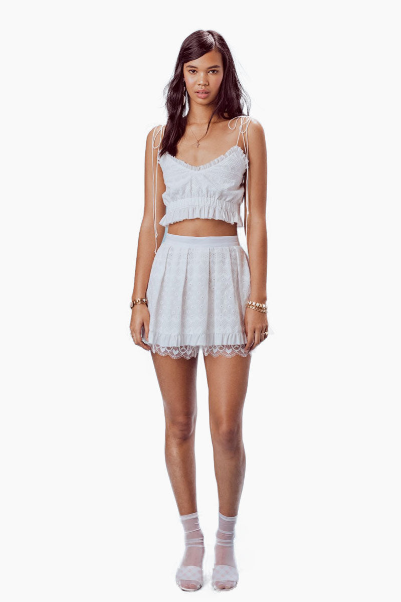 FOR LOVE AND LEMONS Charlotte Eyelet Mini Skirt - White Heart Skirt | White Heart| For Love And Lemons Charlotte Eyelet Mini Skirt - White Heart Features:  Pleated Skirt  Built in Lace Shorts Contrast Ruffles Side Pockets Invisible Back Zipper Lined Dry Clean Only Self: 100% Cotton; Contrast: 100% Nylon; Lining: 100% Cotton Front View