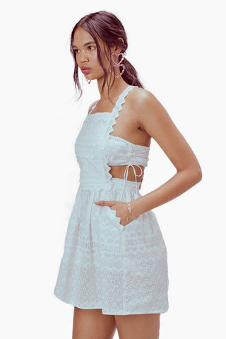 FOR LOVE AND LEMONS Charlotte Eyelet Overalls Mini Dress - White Heart Dress | White Heart| For Love and Lemons Charlotte Eyelet Overalls Mini Dress - White Heart. Features:  Separate Bodice Bandeau Pockets Heart Trim Throughout Back Rose Gold Snaps Adjustable Straps Fully Lined Dry Clean Only Front View
