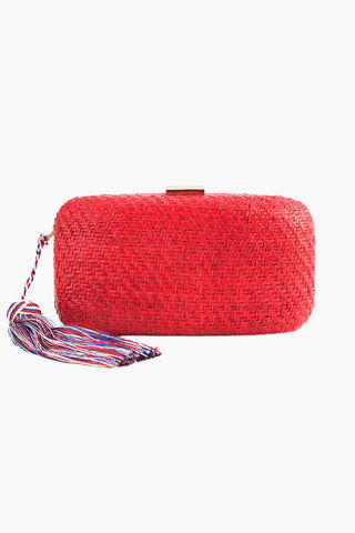 "KAYU Charlotte Silk Tassel Straw Clutch - Red Bag | Red| Kayu Charlotte Silk Tassel Straw Clutch - Red. Features:  Perfect for a breezy summer evening. Charlotte straw clutch features a matching silk tassel and gold-tone closure. Optional drop-in chain strap included. Easily fits standard size cell phone. Measurements: 8""Lx 2"" W x  4""h.  Front View, Closed"