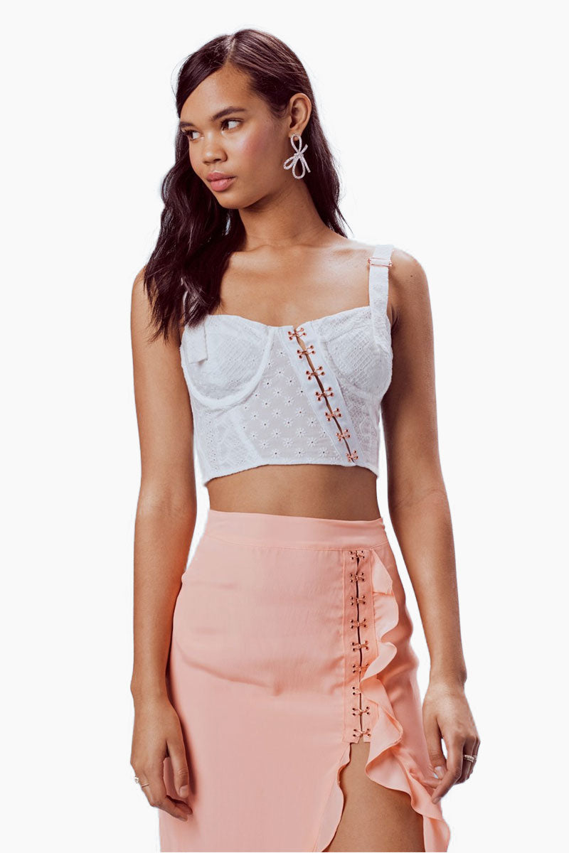 FOR LOVE AND LEMONS Charlotte Eyelet Crop Top - White Heart Top | White Heart | For Love And Lemons Charlotte Eyelet Crop Top - White Heart Features: Asymmetrical Hook-and-Eye Front Closure Underwire Cups Smocked Back Hanging Shoulder Ties Partially Lined Dry Clean Only 100% Cotton; Lining: 100% Cotton Side View