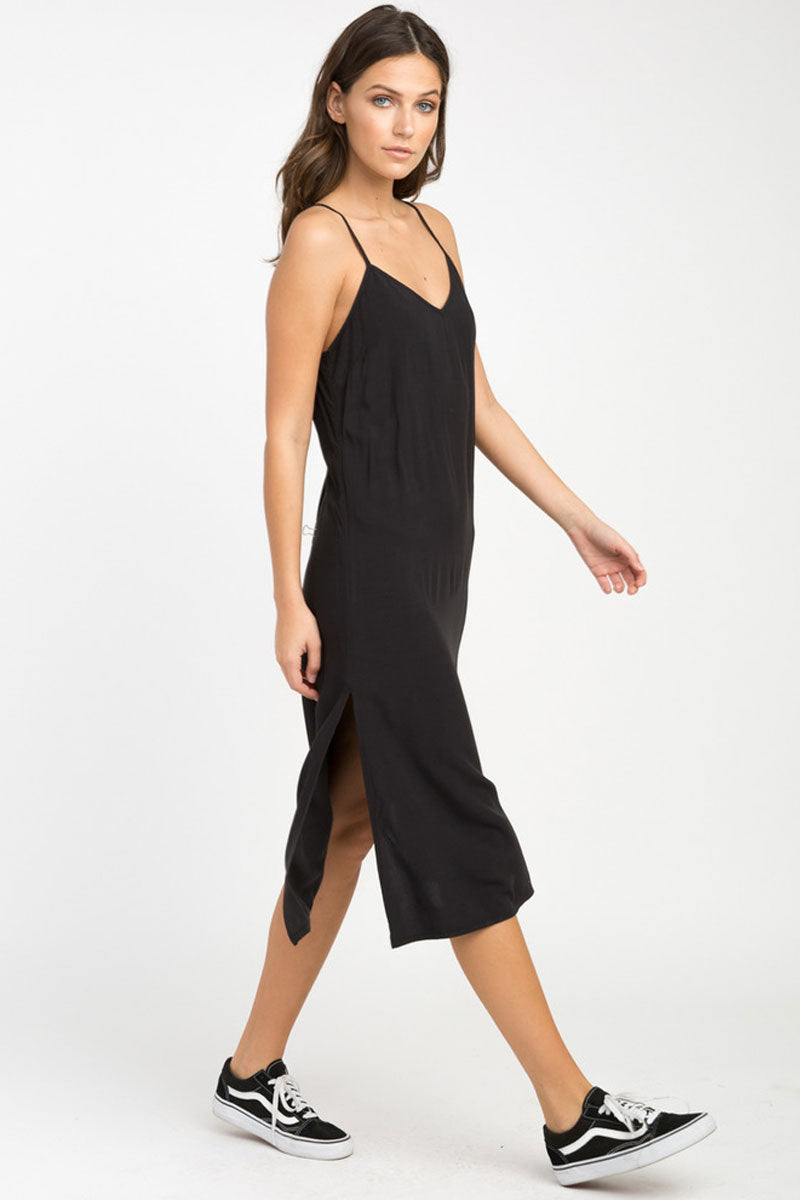 RVCA Chasing Shadows Midi Dress - Black Dress | Black| RVCA Chasing Shadows Midi Dress - Black Midi dress  V-cut neckline Thin spaghetti straps Lightweight woven Cross at the back Side slits that create a flowy silhouette 100% rayon Side View