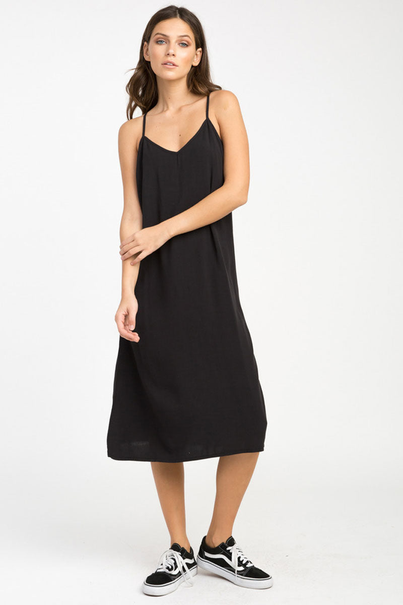 RVCA Chasing Shadows Midi Dress - Black Dress | Black| RVCA Chasing Shadows Midi Dress - Black Midi dress  V-cut neckline Thin spaghetti straps Lightweight woven Cross at the back Side slits that create a flowy silhouette 100% rayon Front View