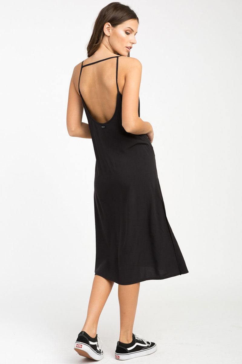 RVCA Chasing Shadows Midi Dress - Black Dress | Black| RVCA Chasing Shadows Midi Dress - Black Midi dress  V-cut neckline Thin spaghetti straps Lightweight woven Cross at the back Side slits that create a flowy silhouette 100% rayon Back View
